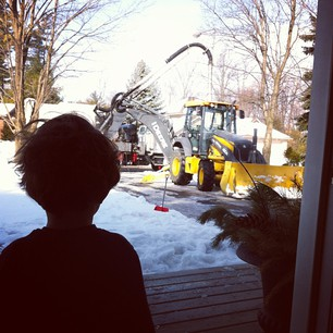 Blake loving the backhoe in the front driveway as they fixed the pipe!