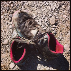 These were grey when I started.  Now soaked with water, filled with pebbles, and caked with mud.