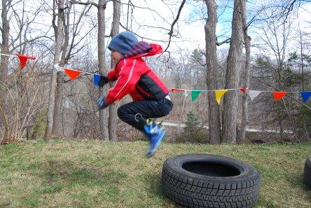 Jumping through four tires.